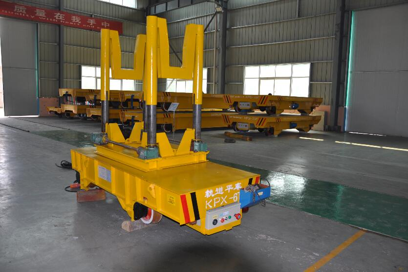 Ladle transport lorry with scale system and tilting device running on turning rail will be manufactured.