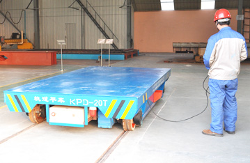 Steel mill apply conductor rail powered cargo handling cart